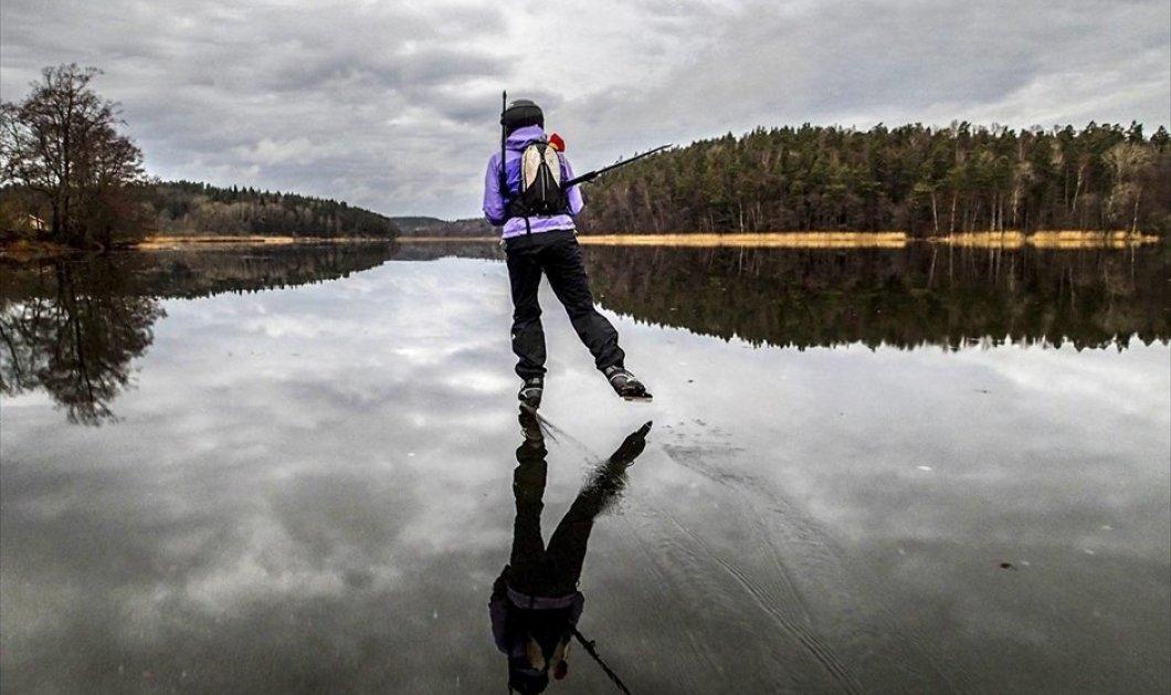 """Εκπληκτικό βίντεο: Δείτε την παγωμένη λίμνη της Σουηδίας να μετατρέπεται σε """"παγοδρόμιο"""" για ανθρώπους και... σκυλιά! - Κυρίως Φωτογραφία - Gallery - Video"""