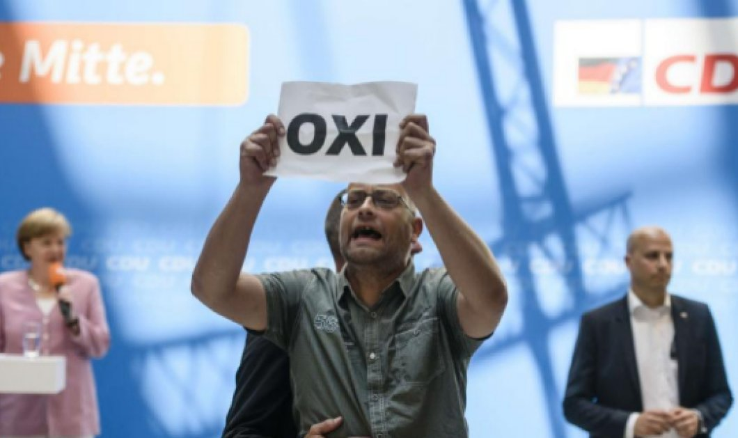 Έλληνες ακτιβιστές διέκοψαν σήμερα την ομιλία της Μέρκελ - Κυρίως Φωτογραφία - Gallery - Video