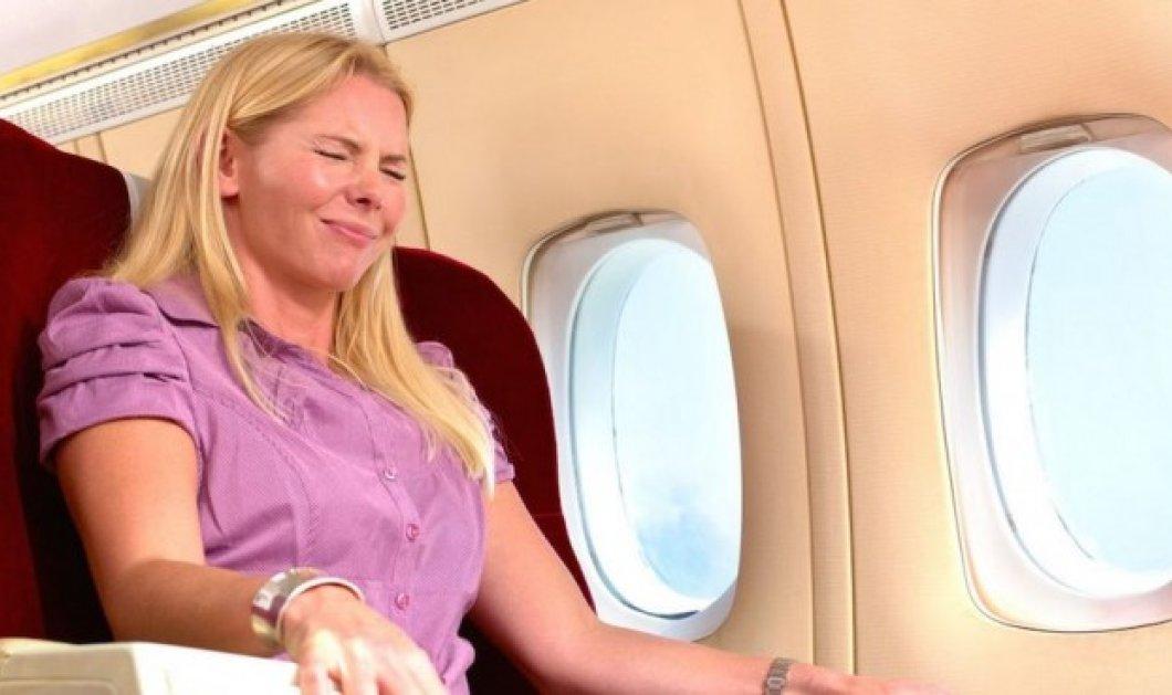 "Smile: Δείτε την τραγελαφική στιγμή της μεγάλης ""πίεσης"" για πας στην τουαλέτα μέσα στο αεροπλάνο - Κυρίως Φωτογραφία - Gallery - Video"