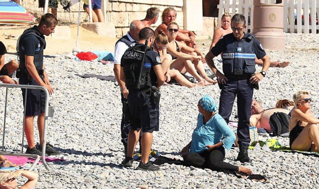 Καρέ- καρέ πως ο Γάλλος αστυνομικός υποχρεώνει την μουσουλμάνα να βγάλει το μπουρκίνι στην παραλία   - Κυρίως Φωτογραφία - Gallery - Video