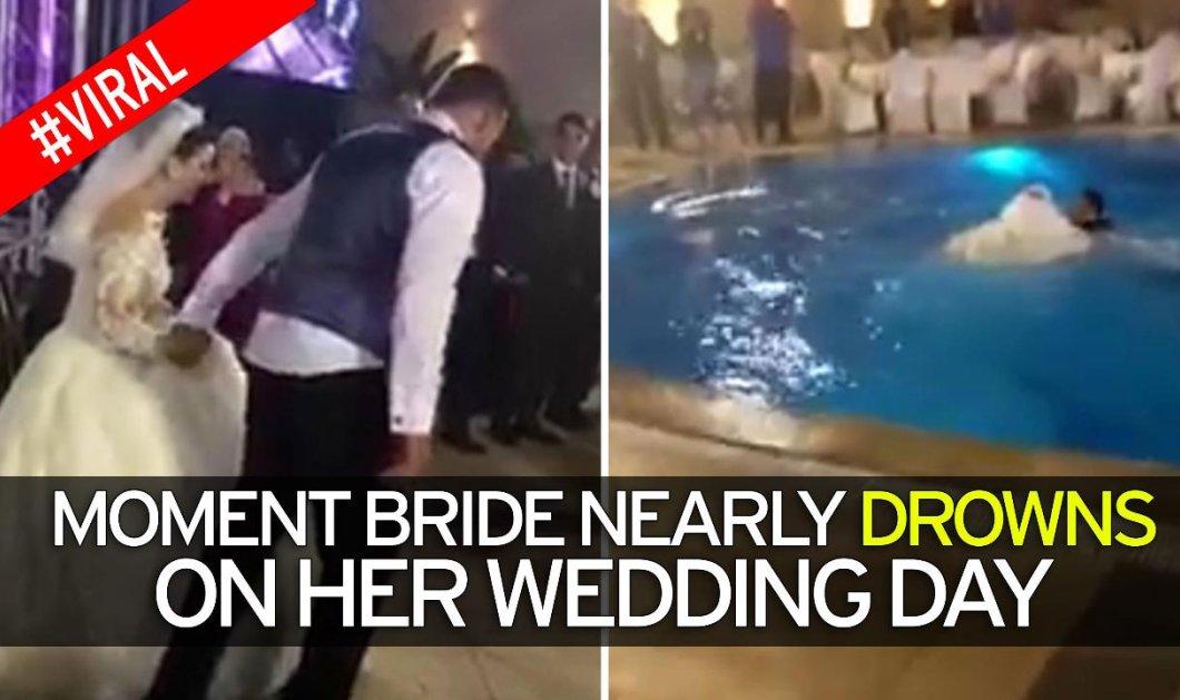 Βίντεο για πολλά γέλια: Νύφη βούτηξε στην πισίνα με νυφικό - υπερπαραγωγή & την έβγαλαν..... με κοντάρι - Κυρίως Φωτογραφία - Gallery - Video