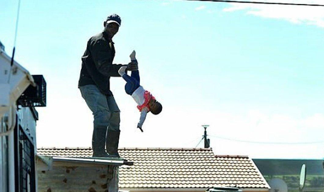 """Απερίγραπτες εικόνες: Πατέρας """"πετάει"""" την 1 έτους κορούλα του από την ταράτσα για να... αποφύγει την κατεδάφιση (ΦΩΤΟ) - Κυρίως Φωτογραφία - Gallery - Video"""