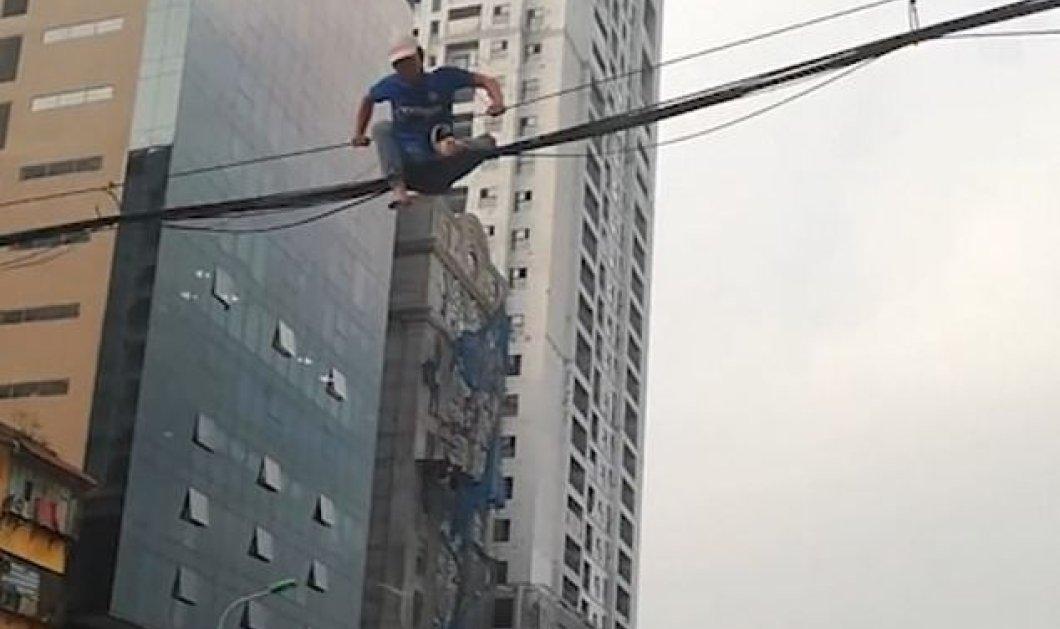 Story of the day: Άνδρας ανέβηκε σε καλώδια ρεύματος για να αποφύγει την... κίνηση! - Κυρίως Φωτογραφία - Gallery - Video