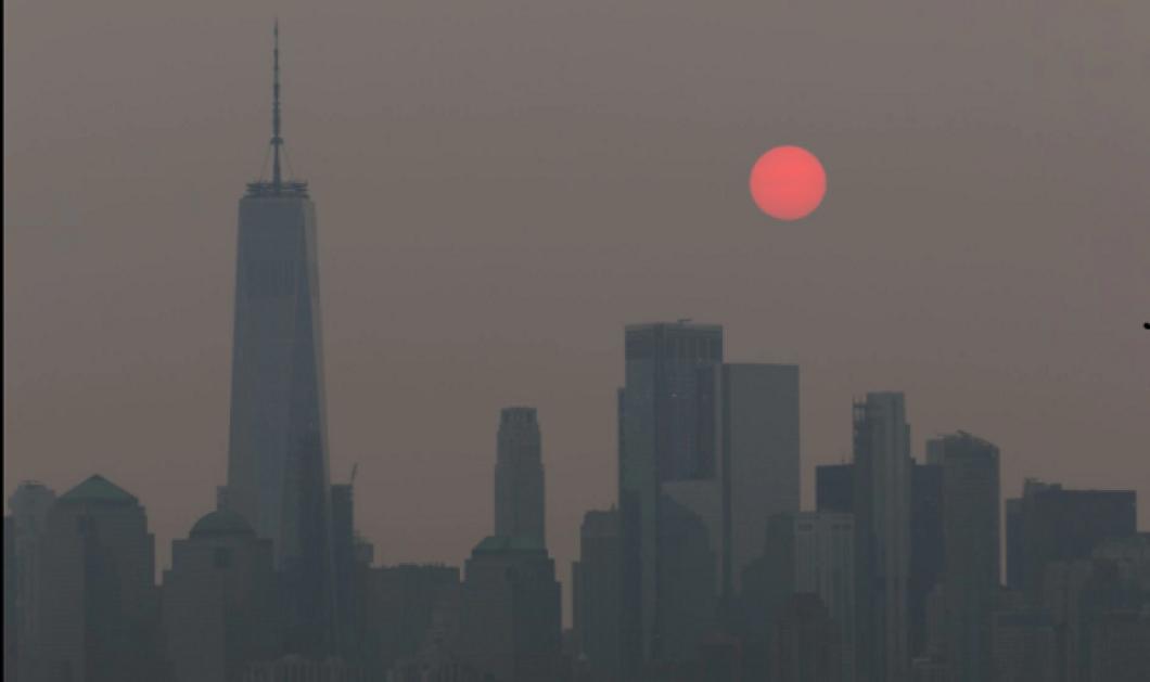 Ένας «κόκκινος ήλιος» πάνω από το Μανχάταν: Ο καπνός από τις πυρκαγιές που μαίνονται «πνίγει» τους Νεοϋορκέζους (φωτό & βίντεο) - Κυρίως Φωτογραφία - Gallery - Video