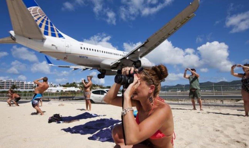 H φωτογραφία της ημέρας - Εκεί που τα αεροπλάνα πετούν λίγα μέτρα πάνω από τα κεφάλια του κόσμου! - Κυρίως Φωτογραφία - Gallery - Video